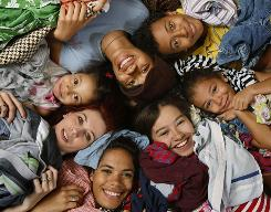 Katherine Motley organized clothing swaps in her community. She's here with six of her seven kids (clockwise from bottom): Alexis, 19; mom Katherine; Zoe, 4; Heather, 14; Evan, 11; Sydney, 5; and Gabrielle, 13.
