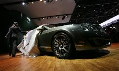 A model unveils the Bentley Continental GTC Speed.