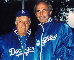 Former L.A. Dodgers pitching great Sandy Koufax, right, with ex-team manager Tommy Lasorda.