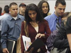 People wait in line to talk to job recruiters at a career fair in Los Angeles.