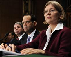 Elizabeth Warren , chairwoman of the Congressional Oversight Panel for the Troubled Asset Relief Program, listens to opening remarks at a hearing called by the Senate Banking Committee. With her are Gene Dodaro , acting comptroller general for the United States Government Accountability Office (GAO), left, and TARP Special Inspector General  Neil Barofsky.