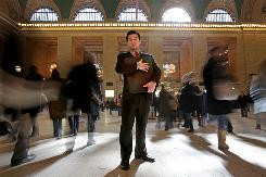 Graphic designer Fred Jung, 35, in New York's Grand Central Station with his portfolio after meeting a job recruiter. The father of two lost his job in January.