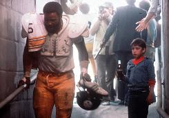 Pittsburgh Steeler Joe Greene and Tommy Okon in the Coca-Cola ad that made its mark for both of its stars. The shoot took longer, Greene says, partly because he kept burping. 