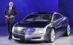 "General Motors Vice Chairman Robert ""Bob"" Lutz and the Cadillac Converj concept at the Detroit auto show on Jan. 11."