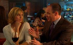A woman and Rich Eisen discuss tax issues at a bar during an ad that teams The Millionaire Matchmaker with TurboTax.