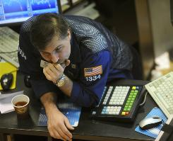 Geoffrey Friedman of Barclays Capital leans on his trading post on the floor of the New York Stock Exchange Tuesday,