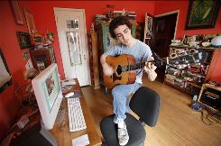 Edison Mellor-Goldman makes how-to-play-the-guitar videos using his iMac's iMovie software, then posts them online at YouTube under the name Duck97.