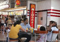 Customers eat at a McDonald's in Schiller Park, Ill. Sales at McDonald's stores open at least a year rose 5.4% in January.