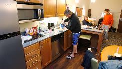 Jack Michetti, left, Keith Cattanach and Anthony Michetti of Detroit hang out in their room at the Hyatt Summerfield Suites extended-stay hotel in Sandy, Utah. The guys are in the area to ski.