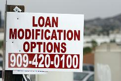 A sign advertising loan modifications in Corona, Calif. The state's tortured real estate market has brought heartbreak and ruin to many families.