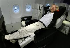 Richard Branson, chairman of Virgin Group, relaxes in a first-class seat on a Virgin America Airbus A319 at Logan airport in Boston earlier this month.