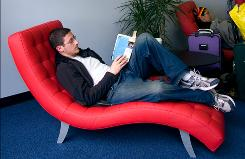 Kevin Samnick of Washington, D.C., relaxes in DFW's new Terminal B, Gate 28 Comfort Zone as he waits for his connection.