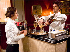 """Actors Lizzy Caplan and Adam Scott in an episode of the clever workplace sitcom """"Party Down,"""" airing on Starz."""