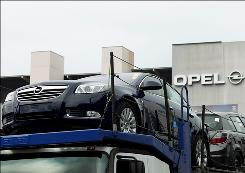 New Opel vehicles leave the factory in Ruesselsheim, Germany, on Friday.
