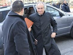 Bernard Madoff arrives at court in New York on Jan. 14 for a hearing. His attorneys say that the $7 million apartment where he's under house arrest, $45 million in bonds and $17 million in a bank belong to his wife.