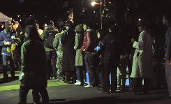 People line up for a free dinner at the New Year's Village for Temporary Workers on Dec. 31 at Tokyo's Hibiya Park. Japanese companies typically only hire fresh graduates.