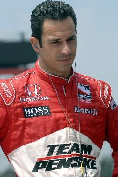 Driver Helio Castroneves waits for the start of the Honda Indy 200 auto race last July.