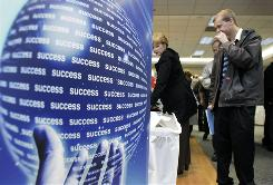 "People attend a job fair in Wayne, Mich. The fair was sponsored by ""Michigan Works!"" a workforce development association."