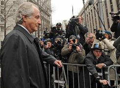 Bernard Madoff exits court in New York on Tuesday.