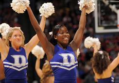 The Duke Blue Devils cheerleaders cheer on their team against the Florida State Seminoles in the Finals of the 2009 ACC Tournament. Duke defeated Florida State 79-69.