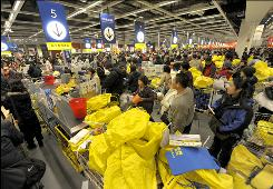 Shoppers line up at the cashier at a furniture mall in Beijing. China's consumer confidence is at its lowest in six years.