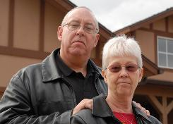 "Steve and Shirley Morse of Prescott, Ariz. stand in front of their home that they are giving up to foreclosure. After using their retirement funds to finance the home after moving from Southern California, the couple found themselves ""upsisde down in debt"" and had to file for Chapter 7 bankruptcy."