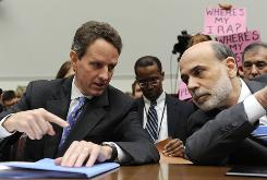 Treasury Secretary Timothy Geithner, left, talks with Federal Reserve Chairman Ben Bernanke before a House Financial Services Committee hearing.