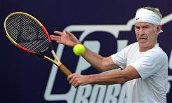 John McEnroe hits a return during an exhibition match against Swedish tennis legend Bjorn Borg in Bangkok in November 2008.