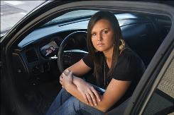 Hilary Davidson's father, Paul, was killed in a car accident caused by a driver who was texting while driving. The Arkansas State University student proposed a bill that bans sending text messages while driving.