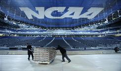 Workers at Detroit's Ford Field on Thursday move a pallet of basketball court flooring that will be installed for this weekend's Final Four games.