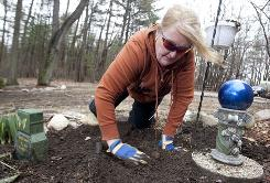 Debra Martin, a workplace safety specialist, is traveling less and spending more time in her Kent City, Mich., home. With her new extra time, she's gardening and planting blubs as she always wanted but never had time to do.