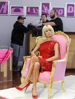 Paris Hilton and a camera crew behind her wait for shooting to begin on the set of the reality show Paris Hilton's My New BFF,  in Beverly Hills, Calif.