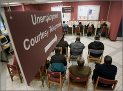 A line for unemployment benefits info at an Employment Development office in San Jose, Calif.