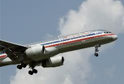 An American jet prepares to land at Dallas/Fort Worth International. The airline reported a $375 million loss Wednesday.
