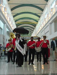 A jazz band greets fliers at Louis Armstrong airport in New Orleans. AeroMexico is restarting service from the facility.