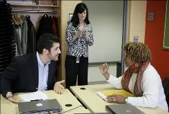 Students Delphia Simmons, right, and Jon Baugh negotiate as instructor Melissa Price critiques them during their class at Wayne State on April 15.