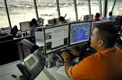 Operations specialist Jimmy Gallo monitors AirTran flights from the concourse D control tower at Hartsfield-Jackson International Airport in Atlanta.