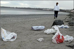 "Plastic bags on a beach in Ireland. Makers of plastic bags are making ""significant"" steps to reduce waste, Keep America Beautiful's president says."