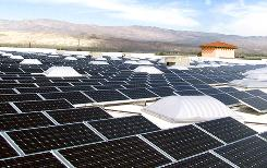 A solar installation fills the rooftop of a Palm Desert Sam's Club in California. Wal-Mart aims to buy the green power at prices equal to or less than traditional energy.