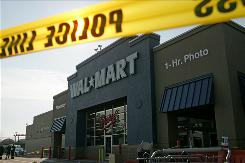 Nassau County Police examine the front of the Wal-Mart in Valley Stream, N.Y., last November.
