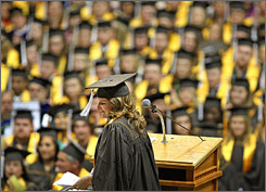 Univeristy of Wyoming graduate Kelsey Day finishes her commencement speech on Saturday. Many grads will struggle paying off student loan debt.