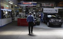 Stanley Balzekas III walks through the service area Thursday of his family's Chrysler dealership, Balzekas Motor Sales, in Chicago. The dealership, which has been part of the Chrysler family since 1933, was on the list of 789 dealers the automaker plans to close.