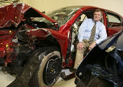 Safety advocate Adrian Lund, president of the Insurance Institute for Highway Safety, sits in a '09 Camry used in a crash test. He has been one of the most outspoken opponents of the move to smaller cars.