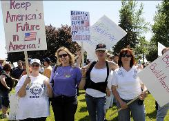 "United Auto Workers, from left, Janice Tennant, Mary Ward-Schiffert, Ann Marie Hacker, and Sandy Leffer attend a ""Save America Rally"" at the Delphi Plant in Lockport, N.Y., last week. GM is assuming ownership of the plant and four others."