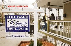 A buyer visits a condominium for sale in Massachusetts last month.