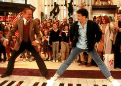 "Robert Loggia, left, and Tom Hanks in a scene from the 1988 motion picture ""Big."" filmed in the flagship FAO Shwarz store in New York. The retailer is being bought by Toys R Us."