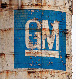 Paint peels in May from a GM logo on a shuttered assembly plant in Janesville, Wis.