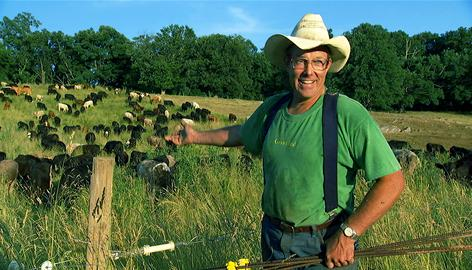"Joel Salatin of Polyface Farm shows off his grass-fed herd in ""Food, Inc."" Filmmaker Robert Kenner lifts the veil on the nation's food industry, showing viewers where the food that sustains us comes from."