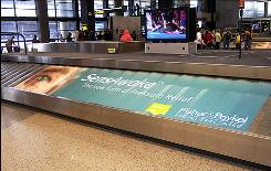 DoubleTake Marketing placed an ad for SensAwake on a baggage carousel in Seattle.