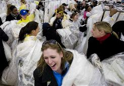 "Brides-to-be and their friends join in the ""Running of the Brides"" at Filene's Basement in February 2008 in New York."